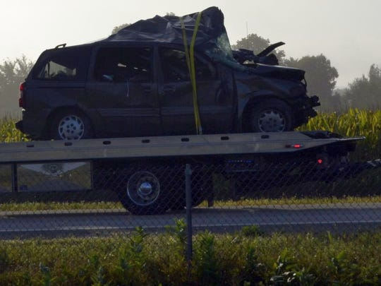 One of the vehicles involved in an early-morning crash on Interstate 41 in the Town of Lawrence is taken away by a tow truck on French Road, adjacent to the interstate, after responders and investigators cleared the scene on southbound 41 on Sunday morning, Aug. 28, 2016.