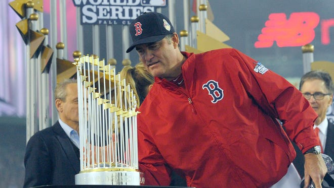 John Farrell is presented with World Series championship trophy.