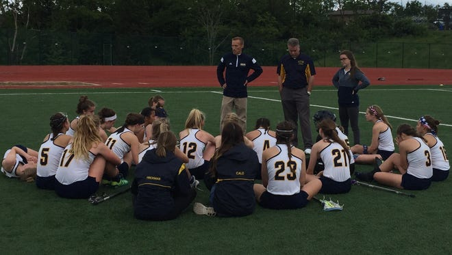 Notre Dame Academy head coach Jimmy Marshall talks to his team after Saturday's loss to Louisville Ballard.
