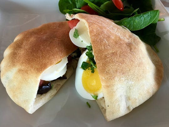 Perfectly hard-boiled eggs peek out from the Sabih Pita at Cafe YOU.