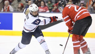 Center Brianna Decker, seen here in 2013, and her Team USA teammates could be boycotting the 2017 IIHF Women's Hockey World Championships.