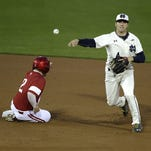 Notre Dame infielder Lane Richards (4) turns the double play as Indiana outfielder Alex Krupa (2) slide into second base in the 4th inning during their game Tuesday, April 26, 2016, evening at Victory Field in Indianapolis.