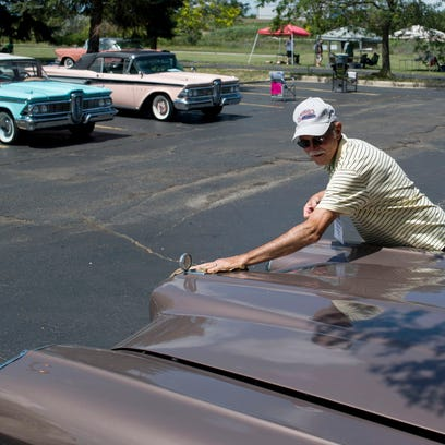 Charles Giesman, of Evansville, Indiana, washes his