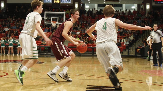 Strafford 2015 graduate Kyle Foley (center) will continue his basketball career at North Arkansas College.