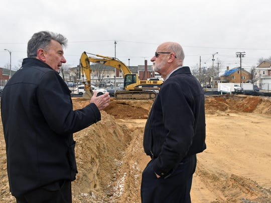 Builder Arthur J. Ogren Jr. of New Road Construction  and Ogren Construction Manager  Dave Macken chat about the project of Millville Arts & Innovation Center in Millville.  Jan. 22, 2015