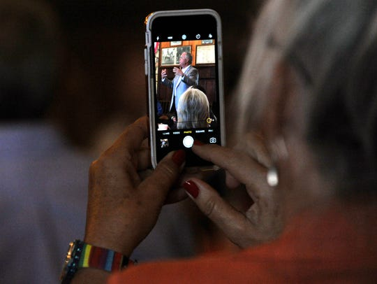 An attendee records video of District 72 State Rep. Drew Darby during his remarks Tuesday Oct. 10, 2017, in Stamford. Darby and other politicians attended a Republican meet-and-greet luncheon at the Texas Cowboy Reunion Bunkhouse.