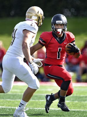 St. Cloud State's Jaden Huff runs with the ball during Saturday's game at Husky Stadium in St. Cloud.
