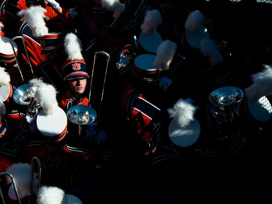 A member of the Auburn University Marching Band prepare