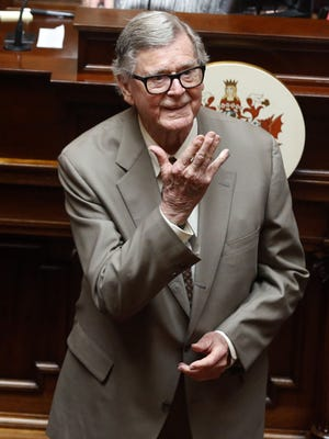 "In this Wednesday, April 3, 2013, file photo, author Earl Hamner Jr. blows a kiss to relatives in the gallery as he is honored by the Virginia Senate at the state capitol in Richmond, Va. On Thursday, March 24, 2016, Hamner, who created ""The Waltons"" television show, died in Los Angeles at the age of 92, according to Ray Castro Jr."