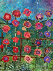 "The quilt ""Blue Mountain Hollyhocks"" will be one of  35 mini-quilts, by artists from throughout the state, in a new exhibit at the New Mexico Farm & Ranch Heritage Museum."