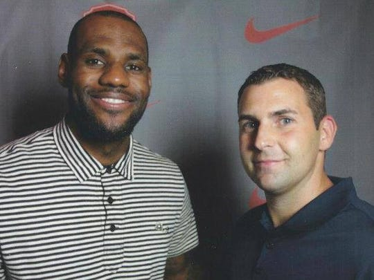 Former Indiana University manager Adam Tatalovich poses for a photo with Cleveland Cavalier standout LeBron James.