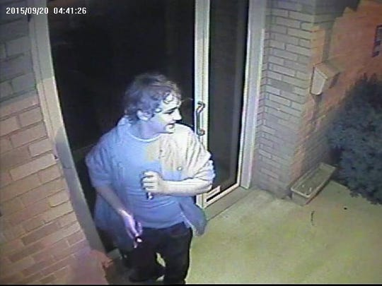In this surveillance image released by Delaware State Police, one suspect appears to be smiling during a Sept. 20 burglary attempt at  St. Mark's United Methodist Church in Stanton.