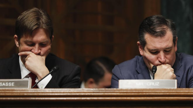 """Senate Judiciary Committee Sen. Ben Sasse, R-Neb., left, and Sen. Ted Cruz, R-Texas listen on Capitol Hill in Washington, Wednesday, May 3, 2017, as FBI Director James Comey testified before the committee's hearing: """"Oversight of the Federal Bureau of Investigation."""" (AP Photo/Carolyn Kaster)"""