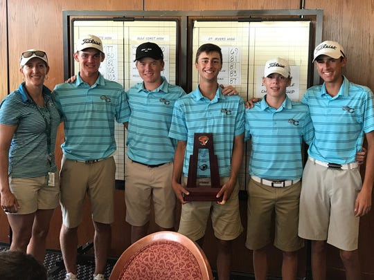 The Gulf Coast High School boys golf team poses with the Class 3A-District 15 championship trophy. The Sharks won the team title at Twin Isles Country Club in Punta Gorda on Monday.