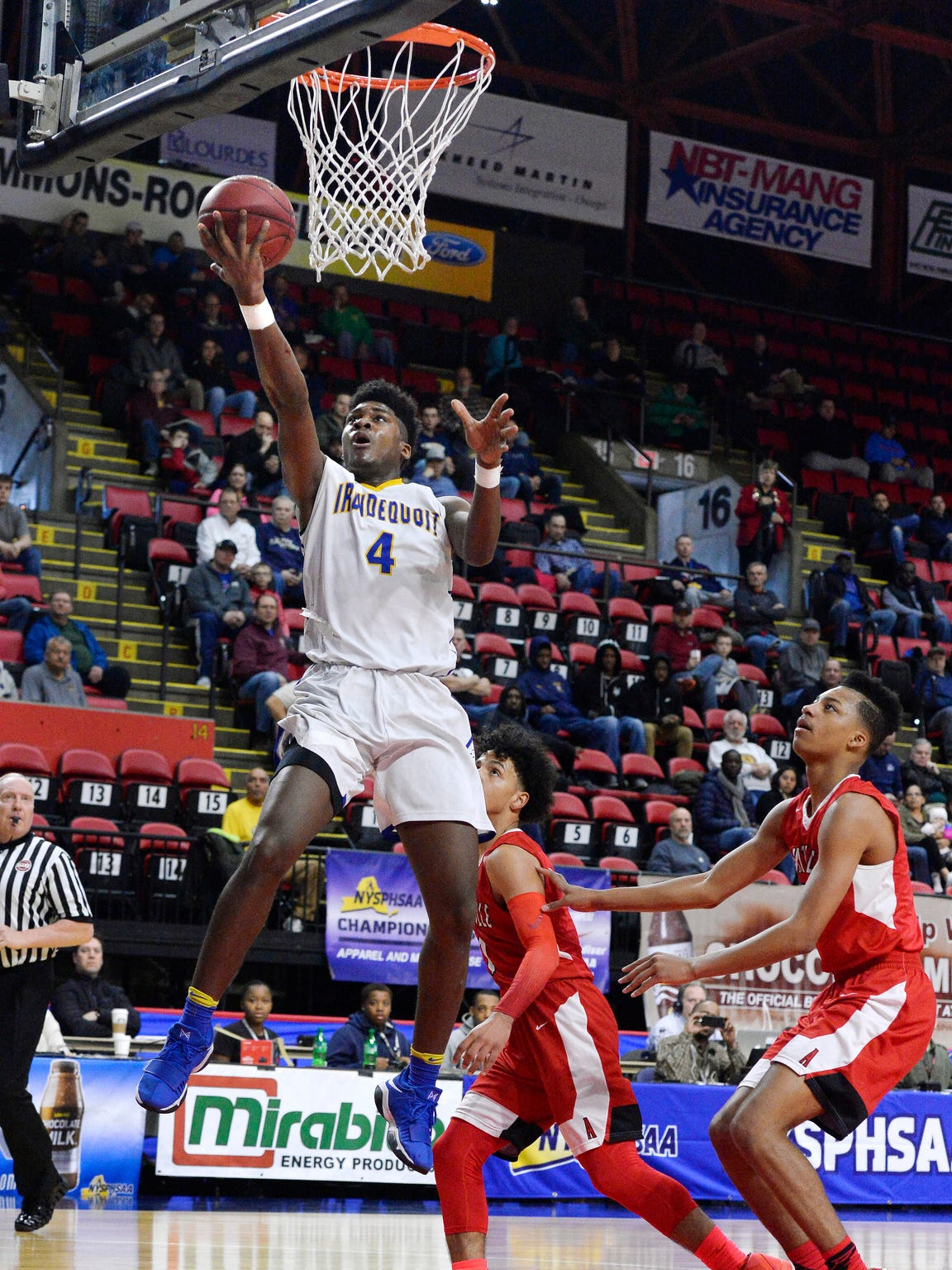 Irondequoit's Gerald Drumgoole drives to the basket