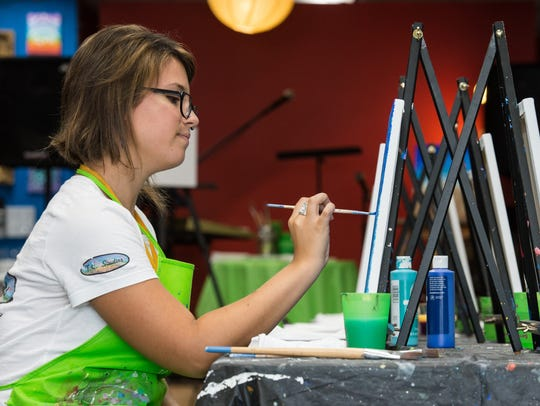 Alexandra Jacobs paints a picture at OC Painting Experience