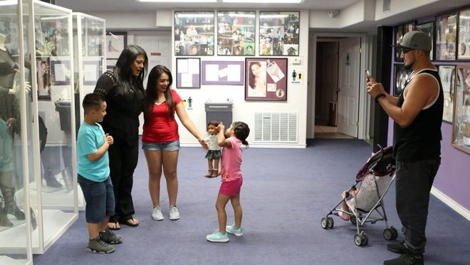 GABE HERNANDEZ/CALLER-TIMES Suzette Quintanilla Arriaga talks to the Fernandez family at the Selena Museum on April 20. The museum is full of memorabilia from Selena's life, and attracts thousands of fans annually.