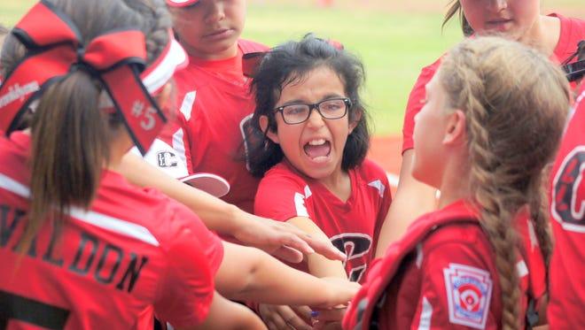 Alissa Carrillo breaks a team huddle for Copper Lg. 9-10 all stars in 5-1 victory over Silver City.