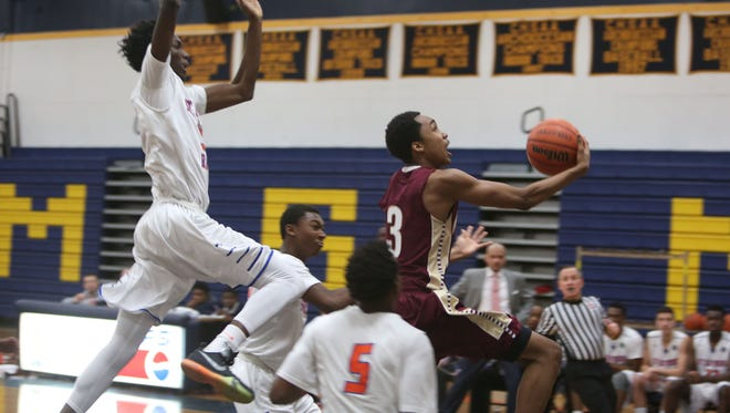 Bryce Wills drives to the basket during a 2016 CHSAA playoff against St. Raymond at Mount St. Michael in the Bronx.