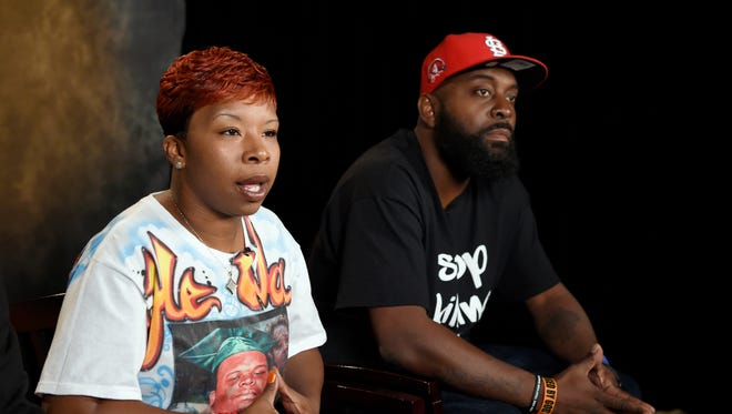 In this Sept. 27, 2014 file photo, the parents of Michael Brown, Lezley McSpadden, left, and Michael Brown Sr., sit for an interview with the Associated Press in Washington.