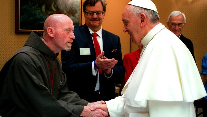 Rev. Wil Tyrrell greets Pope Francis at the end of a conference on human liberation and suffering in Italy last June. Tyrrell is director of the Duchesne Center & Study Abroad Program, and the Catholic Chaplain at Manhattanville College.