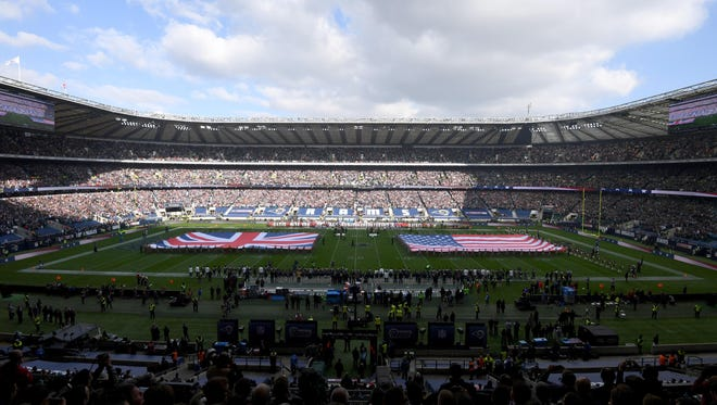 Oct 23, 2016; London, United Kingdom; General view of Twickenham Stadium with British and United States flags on the field during the playing of the national anthems before game 16 of the NFL International Series between the New York Giants and the Los Angeles Rams.