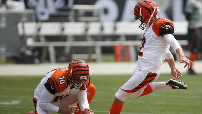 Cincinnati Bengals kicker Mike Nugent (2) practices kicks on the baseball dirt prior to the NFL football game between the Cincinnati Bengals and Oakland Raiders, Sunday, Sept. 13, 2015, at O.co Coliseum, in Oakland, California.