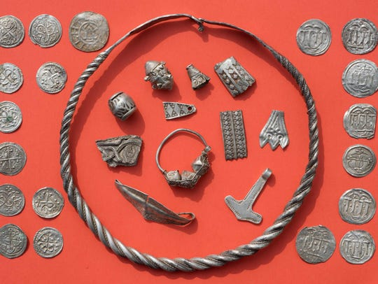 Parts of the silver treasure are pictured on a table