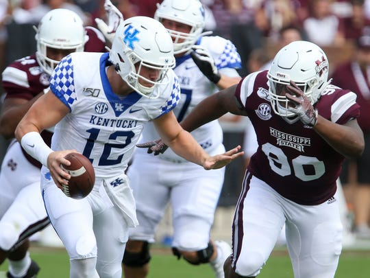 Kentucky quarterback Sawyer Smith (12) attempts to get past Mississippi State defensive tackle Lee Autry (90) during the first half of an NCAA college football game, Saturday, Sept. 21, 2019, in Starkville, Miss. (AP Photo/Kelly Donoho)