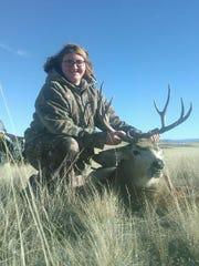 Jordan Ketcham with her mule deer.