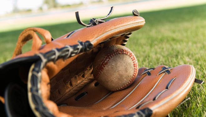Baseball Glove and Ball Lying on Field