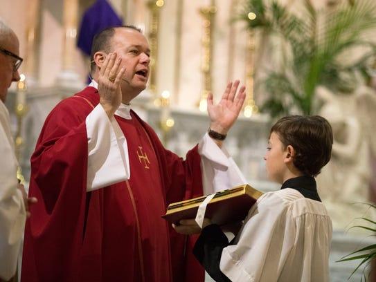 Diocesan Vicar General Msgr. Steven Hurley prays during