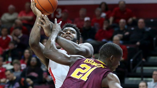 Minnesota center Bakary Konate, (21), tries to block a shot by Rutgers forward D.J. Foreman (1) during the first half Saturday.