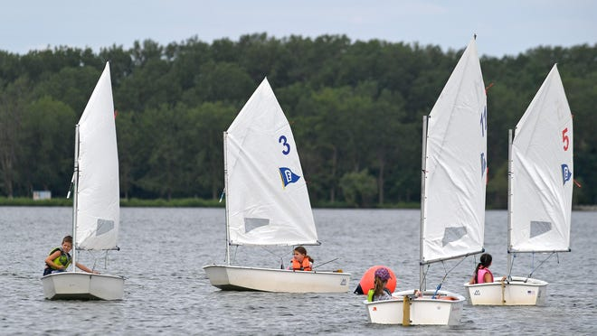 Young sailors take part in a Reyburn Sailing School program Wednesday on Presque Isle Bay, just off the Rickloff Community Boathouse at the Erie Yacht Club. From left are Wesley Griffith, 9; Danielle Spry, 8; Lindsey Raimy, 9; and Sophia Hanes, 8.