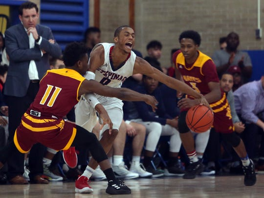 Iowa point guard target Joe Toussaint (11) tries to poke the ball free from an opponent during a New York high school basketball game in January 2018. Toussaint plays for Cardinal Hayes.