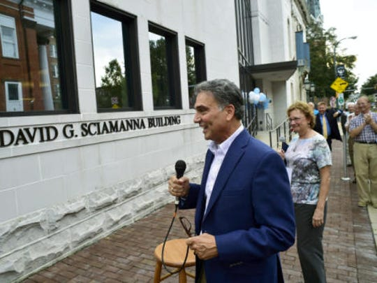 Dave Sciamanna reacts upon learning that a building associated with Greater Chambersburg Chamber of Commerce was named after him in honor of his retirement from chamber president this summer.