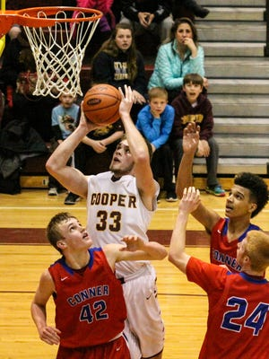 Colin Hathorn goes up for a shot among three Conner defenders during their 33rd District game.