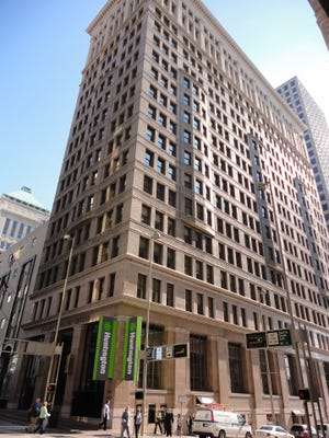 The Fourth & Walnut Centre building will be partially converted into a hotel, its new owner says.