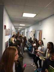 Girls wait in the hallway to see the dean for wearing leggings to school.