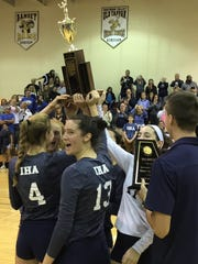 Middle blocker Colette Petric (13) and Immaculate Heart's senior starters hoist the Bergen County girls volleyball championship trophy.