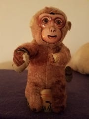 Maria Thys was given this mechanical monkey by her godmother. He was wound with a a key and then poured a bottle of milk into his cup.