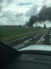 Smoke rises from the scene of a reported plane crash Friday afternoon near the Sheboygan County Memorial Airport.