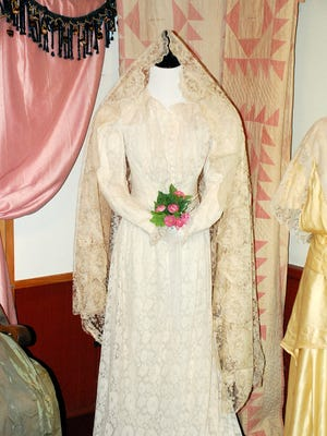 This two-piece ecru lace wedding gown with a bustle and a lace trimmed, ruffled petticoat belonged to an unknown bride around 1885. This was a gift from Judy Dodds, curator of Waitsfield Historical Society.