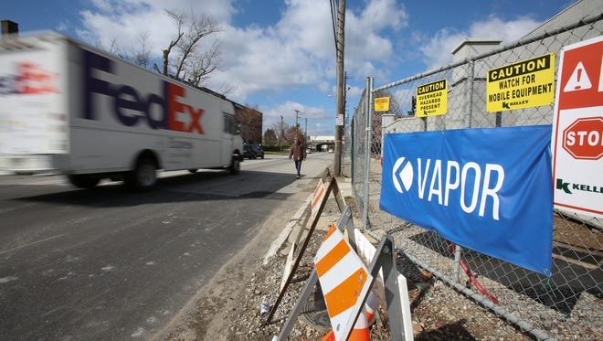 A directional sign on East Breckinridge Street between Brook and Floyd streets points the way to Vapor. Mar. 2, 2017