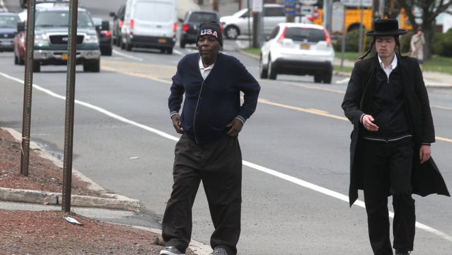 Pedestrians walk along Route 59 in Monsey on April 14. Rockland's various diverse communities' needs often conflict.