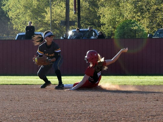 Tioga's Gracie Daigrepont (9, right) steals second against Neville's C.Crosley (3, left) Tuesday.
