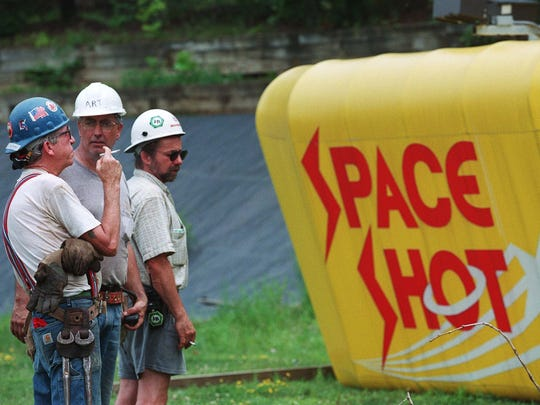 July 23, 1998: Iron workers discussing tactics on removing last ride from Action Park. The new park Mountain Creek has no need for this one and it is being relocated to Canada.