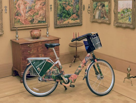 An Indego Bike wrapped in images from the Barnes collection.