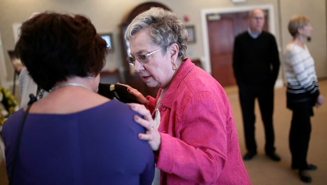 Nancy Carey, center, the wife of Tigers broadcaster Paul Carey, talks to friends and family during the visitation on Friday, April 15, 2016 at the Modetz Funeral Home Silverbell Chapel in Lake Orion.