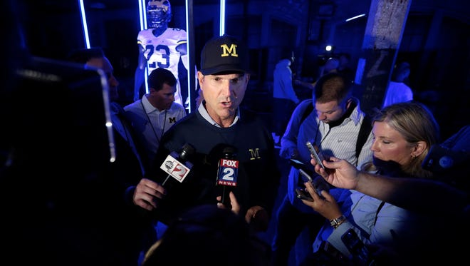 Michigan football coach Jim Harbaugh speaks to the media during the unveil of Nike-designed University of Michigan football uniforms at the Ford Piquette Plant on Tuesday, August 2, 2016, in Detroit.